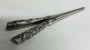 Chinese silver curling tongs mounted with dragons