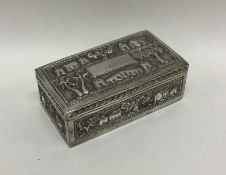 A heavy Asian silver box decorated with buildings.