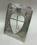 A heavy unmarked silver picture frame of Chinese d