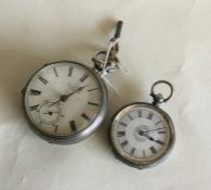 An engine turned silver pocket watch together with