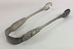 A pair of attractive silver sugar tongs with scrol
