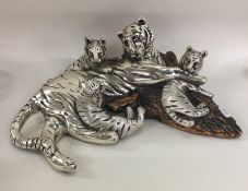 A heavy silver mounted figure of a tiger together