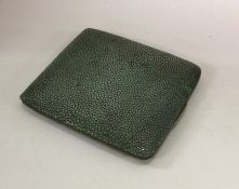 A shagreen mounted cigarette box with hinged mount