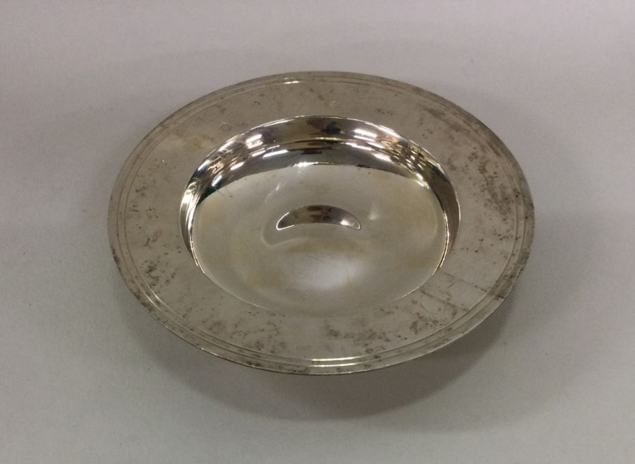 A large circular silver armada dish of typical for