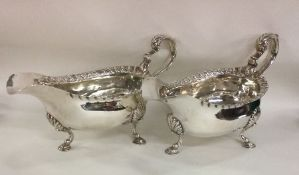 A pair of heavy Georgian silver sauce boats with g