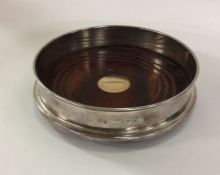 A good silver mounted wine coaster with gold inset