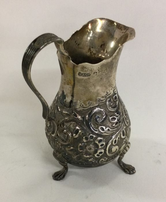 A good baluster shaped cream jug chased with flowe - Image 2 of 2