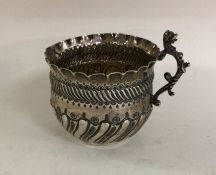 An attractive Victorian silver cream jug of fluted