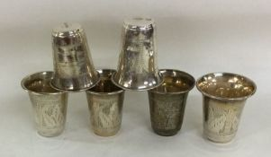 A good set of six silver spirit tots with engraved