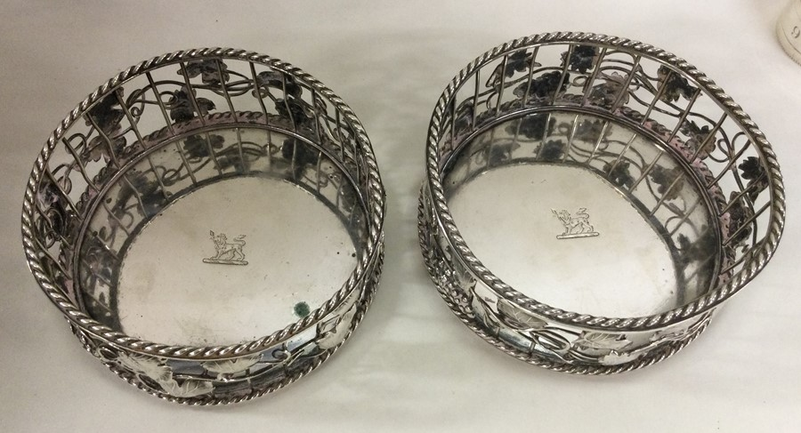 A good pair of George III silver wine coasters att