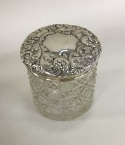 A hobnail cut silver top dressing table jar. Chest