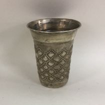 A Continental silver tapering beaker with textured