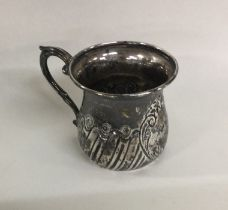 A small silver christening cup with fluted decorat