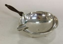 CARTIER: A novelty silver ashtray with turned hand