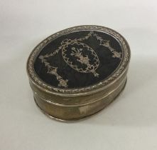 A silver and tortoiseshell inlaid jewellery box of