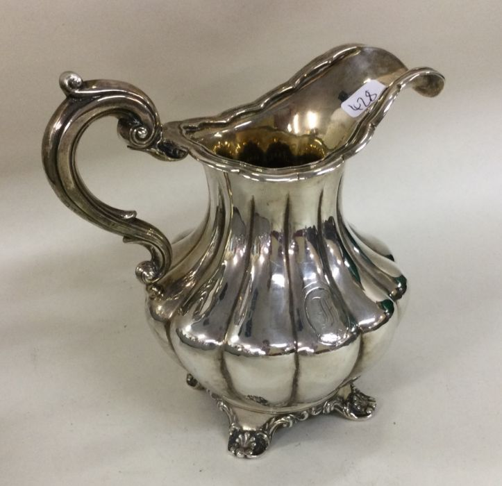 A good half fluted silver cream jug of shaped form - Image 2 of 2