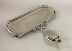 A rare George I silver snuffer tray on four bun fe