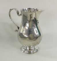 A Georgian silver sparrow beak pitcher cream jug o