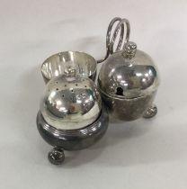 An Edwardian silver cruet of oval form on ball fee