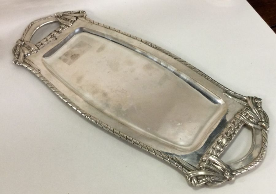 A large oval Austrian silver tray with shaped bord