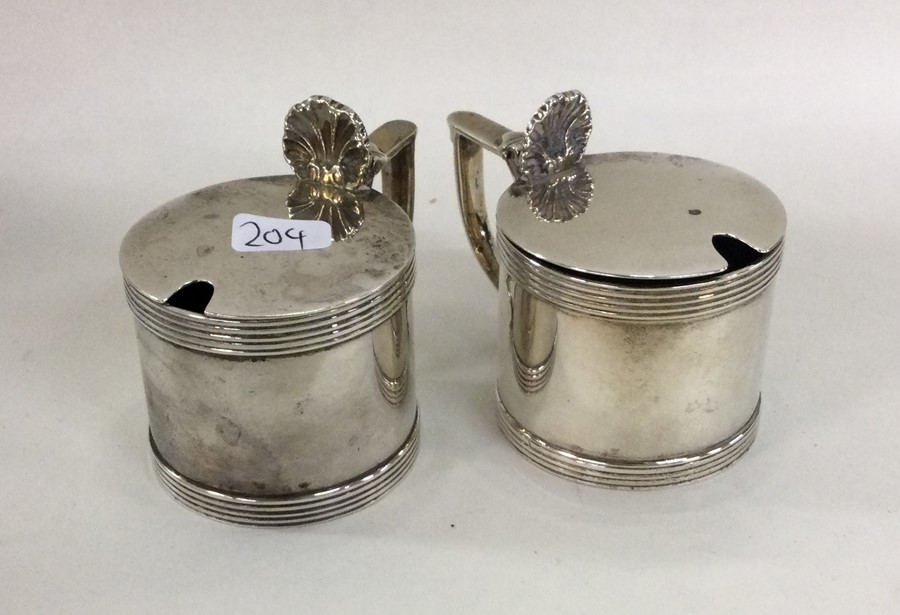 A pair of Edwardian silver mustard pots with shell - Image 2 of 2