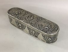 A heavy oval Dutch silver box depicting figures to