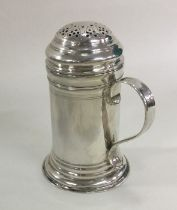 A good heavy George II silver kitchen muffineer of