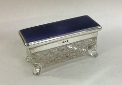 A silver and enamel mounted glass dressing table j