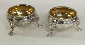 A good pair of engraved silver salts with gilt int