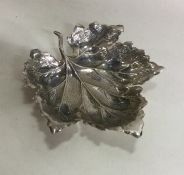 A stylish silver pin dish in the form of a leaf. A