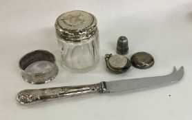 A silver mounted sovereign case, cheese knife etc.