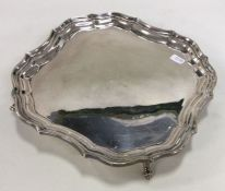 An Edwardian silver waiter of shaped form. Chester