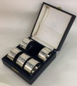 A good set of six numbered silver napkin rings con