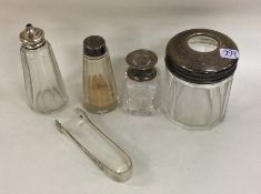 A mixed lot of silver mounted jars and bottles. Va