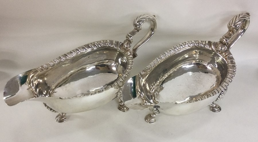 A pair of heavy Georgian silver sauce boats with g - Image 2 of 3