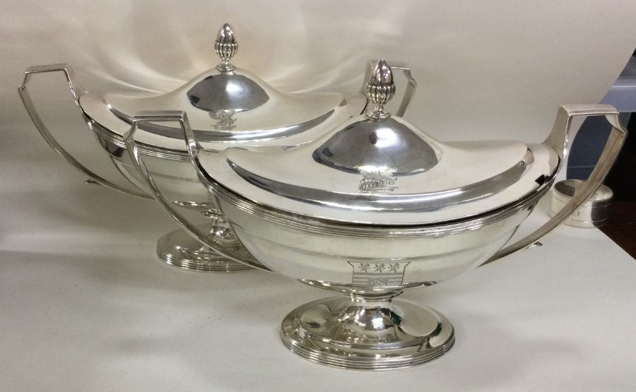 A fine pair of Georgian silver tureens with creste