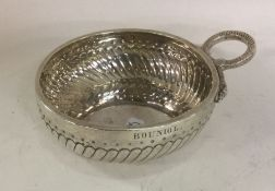 A heavy French silver wine taster with half fluted