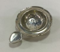 An Edwardian silver shaped tea strainer with pierc