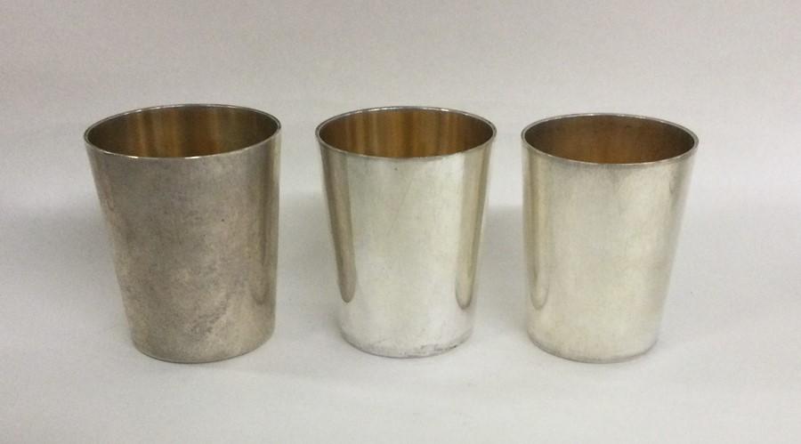 A good set of three tapering silver stacking beake