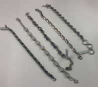 A collection of silver line bracelets. Approx. 80