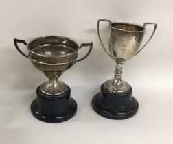 Two silver mounted trophy cups on ebony stands. Va
