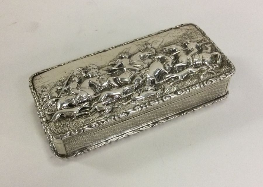A fine cast silver heavy snuff box decorated with