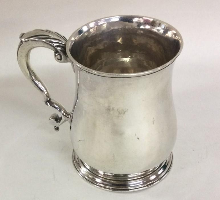 A good Georgian silver half pint mug on spreading
