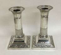 A pair of late Victorian fluted candlesticks with