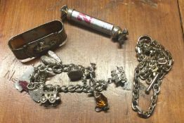 A silver curb link charm bracelet together with a