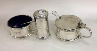 A heavy silver three piece cruet of circular form.