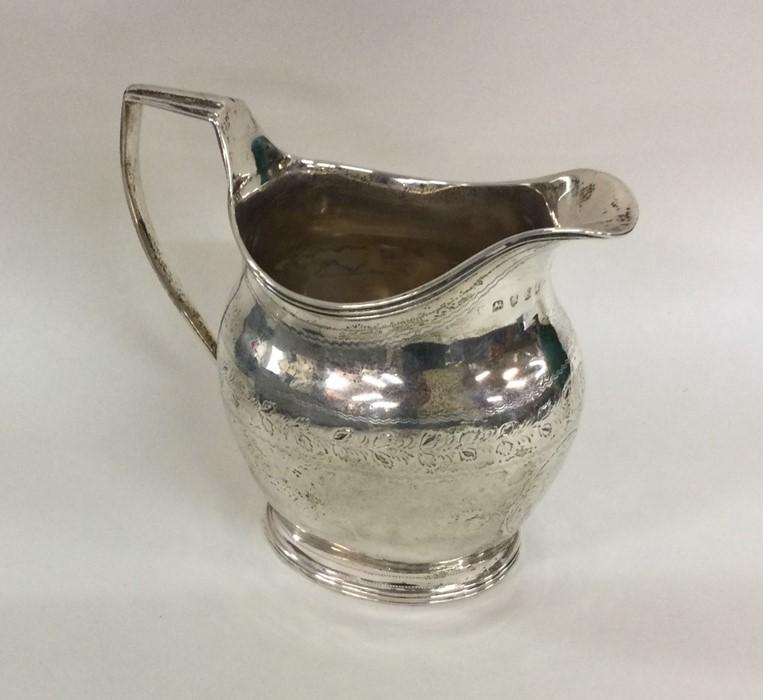 A good George III silver cream jug attractively de