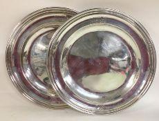 PAUL DE LAMERIE: A rare pair of silver dinner plat