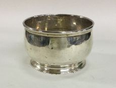 A heavy George II silver bowl on tapering supports
