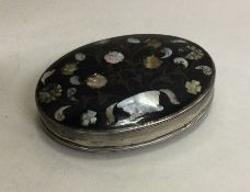 A silver and tortoiseshell inlaid oval snuff box d